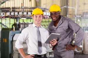 16013902 - modern factory manager and worker with tablet computer