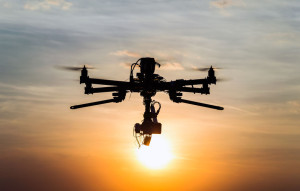 39230811 - drone flying in the sunset